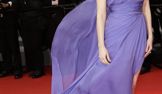 Actress Jessica Chastain poses for photographers as she arrives for the screening of Foxcatcher at the 67th international film festival, Cannes, southern France, Monday, May 19, 2014. (AP Photo/Thibault Camus)
