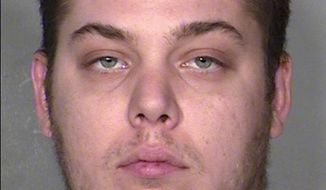 This image provided by the Las Vegas Metropolitan Police Department shows Jim Edward Johnson. A Las Vegas judge set bail at $100,000 and ordered house arrest for Johnson, a 25-year-old Las Vegas man who claims the shooting of his friend, an aspiring rapper and former U.S. Marine, in a suite atop a Las Vegas resort last week was an accident. (AP Photo/LVMPD)