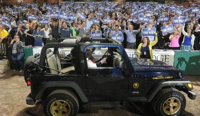 The crowd greets Tom Wolf and his wife Frances as they drive into the rally at Santander Stadium to celebrate winning the Democratic nomination on Tuesday, May 20, 2014. (AP Photo/York Daily Record, Jason Plotkin)