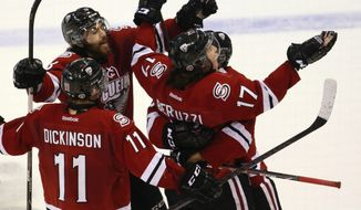 Guelph Storm players celebrate Tyler Bertuzzi's goal against the London Knights during the second period in Game 6 of the CHL hockey Memorial Cup, in London, Ontario, Wednesday, May 21, 2014. (AP Photo/The Canadian Press, Dave Chidley)
