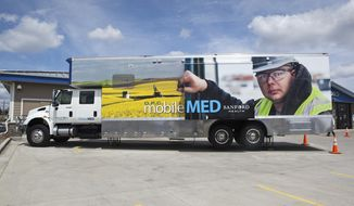 This Monday, May 19, 2014 photo provided by Sanford Health shows a mobile clinic in Bismarck, N.D., that Sanford Health is deploying to boost health care in the western North Dakota oil patch. The Dakotas-based health network will send the first clinic on wheels into the region in June. (AP Photo/Courtesy of Sanford Health)