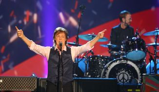 FILE - In this Jan. 27, 2014 file photo, Paul McCartney and Ringo Starr perform at The Night that Changed America: A Grammy Salute to the Beatles,  in Los Angeles. McCartney has canceled his concert in South Korea next week due to the virus-caused illness that forced him to call off his entire Japan tour, organizers said Wednesday, May 21, 2014. The former Beatle, who turns 72 next month, had planned to hold concerts in Japan and South Korea as part of his world tour. (Photo by Zach Cordner/Invision/AP, File)