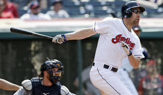 Cleveland Indians' David Murphy watches his ball after hitting a two-run home run off Detroit Tigers relief pitcher Joe Nathan in the ninth inning of a baseball game, Wednesday, May 21, 2014, in Cleveland. Tigers catcher Bryan Holaday watches.  (AP Photo/Tony Dejak)
