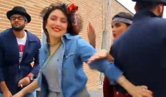 "In this frame grab taken from video posted to YouTube, people dance to Pharrell Williams' hit song ""Happy"" on a rooftop in Tehran, Iran. Police in Iran have arrested six young people and shown them on state television for posting the video. While the song has sparked similar videos all over the world, in Iran some see the trend as promoting the spread of Western culture. And women are banned from dancing in public or appearing outside without the hijab in the Islamic Republic. (AP Photo)"