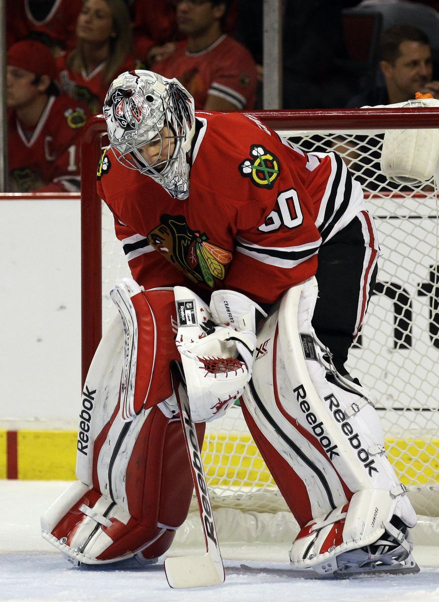 Chicago Blackhawks goalie Corey Crawford looks down after Los Angeles Kings' Tyler Toffoli scored a goal during the third period in Game 2 of the Western Conference finals in the NHL hockey Stanley Cup playoffs in Chicago on Wednesday, May 21, 2014. (AP Photo/Nam Y. Huh)