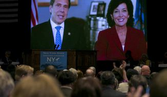 Gov. Andrew Cuomo appears via video with former Congresswoman Kathy Hochul of Buffalo, NY, as his choice to be New York's next lieutenant governor, during the opening session of the state's Democratic Convention, in Melville, N.Y., Wednesday, May 21, 2014. (AP Photo/Richard Drew)