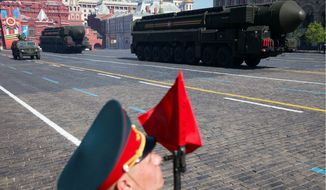 A Russian intercontinental ballistic missile rolls across Red Square during the Victory Day Parade. The launch of the missile was to test a prospective warhead, Interfax news agency quoted the Defense Ministry spokesman Igor Yegorov as saying. (Associated Press)