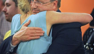 Candidate Bryan Smith consoles his daughter Molly Smith after conceeding to Congressman Mike Simpson during the GOP Primary Elections Tuesday at the Residence Inn in Idaho Falls. (AP Photo/The Idaho Post-Register, Pat Sutphin)
