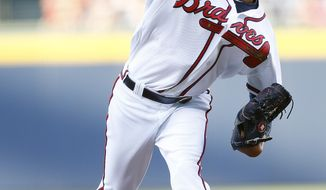 Atlanta Braves starting pitcher Ervin Santana (30) works in the first inning of a baseball game against Milwaukee Brewers Wednesday, May 21, 2014, in Atlanta. (AP Photo/John Bazemore)