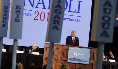 New York state Comptroller Thomas DiNapoli accepts his party's nomination for re-election during the opening session of the state's Democratic Convention, in Melville, N.Y., Wednesday, May 21, 2014.  (AP Photo/Richard Drew)