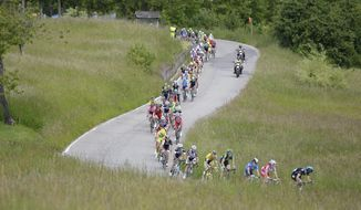 Cyclists pedal during the 11th stage of the Giro d'Italia, Tour of Italy cycling race, from Collecchio to Savona, Italy, Wednesday, May 21, 2014. (AP Photo/Fabio Ferrari)