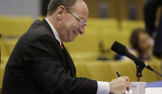 Ralph Gants, currently an associate justice of the Massachusetts Supreme Judicial Court jots down a note during his Governor's Council confirmation hearing to succeed Roderick Ireland as the Chief Justice of the SJC at the Statehouse Wednesday, May 20, 2014 in Boston. (AP Photo/Stephan Savoia)