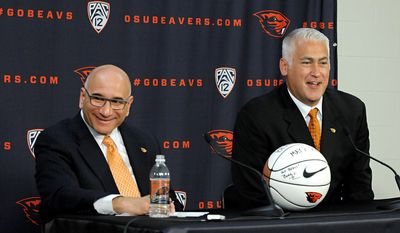 Oregon State men's basketball coach Wayne Tinkle, right, talks with members of the media while joined by athletic director Bob De Carolis during a news conference at Gill Coliseum on Wednesday, May 21, 2014 ,in Corvallis, Ore. (AP Photo/The Gazette-Times, Amanda Cowan)