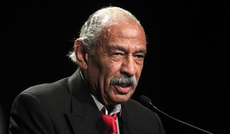 FILE - In this Nov. 6, 2012 file photo, Rep. John Conyers, D-Mich., addresses supporters during the Michigan Democratic election night party in Detroit. A hearing is planned for Wednesday, May 21, 2014 in federal court on a lawsuit filed by the American Civil Liberties Union and joined by longtime Michigan Congressman John Conyers that takes aim at a requirement that petition collectors be registered voters, as part of a larger challenge to an order removing Conyers' name from the primary ballot in August.  (AP Photo/Carlos Osorio, file)