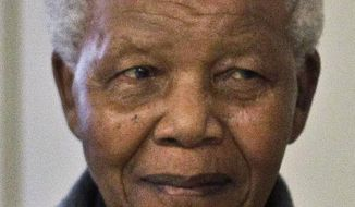 FILE - This photo taken July 18, 2012 shows former South African President Nelson Mandela during the celebration of his 94th birthday in Qunu, South Africa. The National Underground Railroad Freedom Center in Cincinnati, Ohio, has named Mandela and former Polish president Lech Walesa as International Freedom Conductors. The 2014 awards will be presented Aug. 23 in Cincinnati. (AP Photo/Schalk van Zuydam, File)
