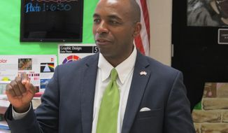 Republican Charles Lollar talks to students in a classroom at Huntingtown High School on Tuesday, May 13, 2014 in Huntingtown, Md. Lollar, who is running in the GOP primary for governor, says cutting taxes is his chief concern.  (AP Photo/Brian Witte)