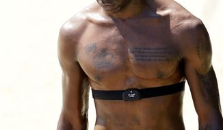 Italian player Mario Balotelli wears a heart rate monitor, during a training session in Coverciano training complex, in Florence, Italy, Tuesday, May 20 , 2014. The Azzurri will train for three days this week then resume full-time preparation next Monday. In Brazil, Italy is in Group D with England, Uruguay and Costa Rica. (AP Photo/Fabrizio Giovannozzi)
