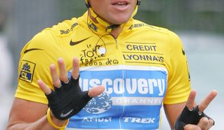 "FILE - In this July 24, 2005  file photo, overall leader Lance Armstrong signals seven for his seventh straight win in the Tour de France cycling race, as he rides during the 21st and final stage of the race between Corbeil-Essonnes, south of Paris, and the French capital. Armstrong has been stripped of his award in the Legion of Honor, the best-known recognition in France.  Armstrong was given the rank of ""Chevalier"" _ or Knight _ in the ""Legion d'Honneur"" in 2005, the last year of his seven consecutive Tour de France victories.  (AP Photo/Peter Dejong, File)"