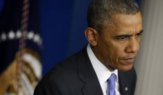 President Barack Obama listens to a question as he speaks to reporters in the Brady Press Briefing Room of the White House in Washington, Wednesday, May 21, 2014, after he met with Veterans Affairs Secretary Eric Shinseki and Deputy Chief of Staff Rob Nabors. (AP Photo/Charles Dharapak)