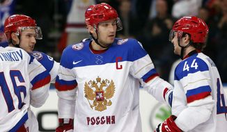 Alexander Ovechkin and his Russian teammates celebrate a goal during the Group B preliminary round match between Russia and Germany at the Ice Hockey World Championship in Minsk, Belarus, Sunday, May 18, 2014. (AP Photo/Darko Bandic)