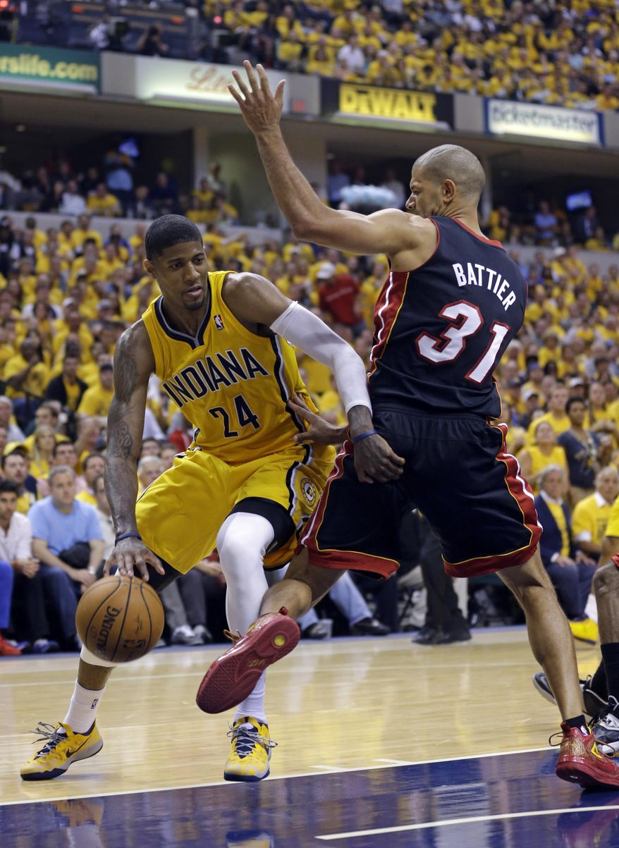 Indiana Pacers forward Paul George, left, drives on Miami Heat forward Shane Battier during the fourth quarter of Game 2 of the NBA basketball Eastern Conference finals in Indianapolis, Tuesday, May 20, 2014. The Heat defeated the Pacers 87-83 to tie the series at 1-1. (AP Photo/Michael Conroy)