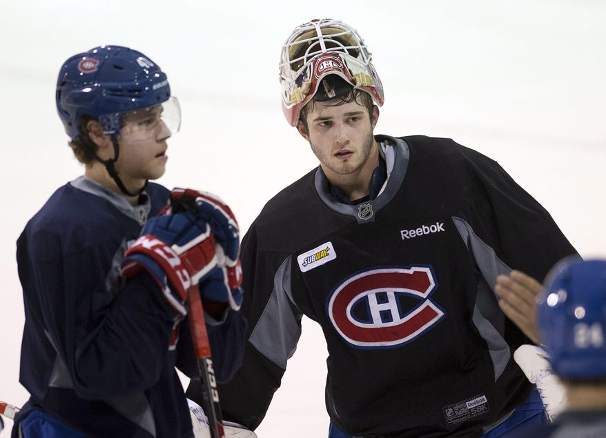 Montreal Canadiens defenceman Nathan Beaulieu, left, and  Canadiens goalie Dustin Tokarski (35) take part in the team's practice Wednesday, May 21, 2014 in Brossard, Quebec.  The Canadiens play the New York Rangers in Game 3 of the Eastern Conference final of the Stanley Cup Playoffs on Thursday in New York. (AP Photo/The Canadian Press, Ryan Remiorz)