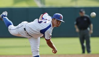 Kansas' Jordan Piche pitches against West Virginia in the first inning of a first-round game in the Big 12 conference baseball tournament in Oklahoma City, Wednesday, May 21, 2014. (AP Photo/Sue Ogrocki)