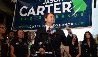 Jason Carter speaks to supporters at his election night headquarters at 5 Seasons Brewing Company, Tuesday, May 20, 2014 in Sandy Springs, Ga.. The former senator is running unopposed in the Democratic primary. (AP Photo/Atlanta Journal-Constitution, Brant Sanderlin)