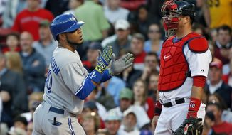 Toronto Blue Jays' Edwin Encarnacion claps as he crosses home plate in front of Boston Red Sox catcher A.J. Pierzynski after his solo home run in the second inning of a baseball game at Fenway Park in Boston, Wednesday, May 21, 2014. (AP Photo/Elise Amendola)