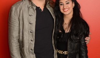 "This 2014 photo released by Fox shows ""American Idol XIII: The Final 2,"" contestants, Caleb Johnson, left, and Jena Irene. The singing contest, in its 13th season, awards a record contract to the winning contestant. The Fox show finale airs on Wednesday, May 21, 2014. (AP Photo/Fox, Michael Becker)"