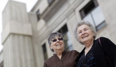 FILE - In this March 10, 2014 file photo Jennie, 72, left, and Nancy Rosenbrahn, 68, stand outside the Pennington County Courthouse in Rapid City, S.D. The Rapid City, SD, couple plans tobe among the first South Dakotans to challenge the state's ban onsame-sex marriage. (AP Photo/Rapid City Journal/Benjamin Brayfield, File)