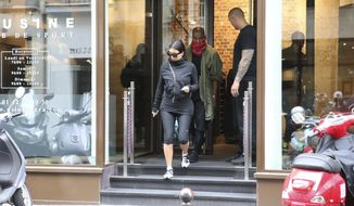 Kim Kardashian and U.S rap singer Kanye West  leave a fitness center in Paris, Wednesday, May 21, 2014. The gates of the Chateau de Versailles, once the digs of Louis XIV, will be thrown open to Kim Kardashian, Kanye West and their guests for a private evening this week ahead of their marriage. (AP Photo/Jacques Brinon)