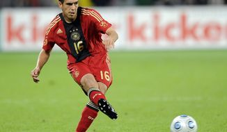 FILE - In this Sept. 5, 2009 file photo, Germany's Philipp Lahm plays the ball during the friendly soccer match between Germany and South Africa in Leverkusen, Germany, Saturday. (AP Photo/Martin Meissner, File) - YOU CAN FIND THE ENTIRE  WORLD CUP COLLECTION ON APIMAGES.COM