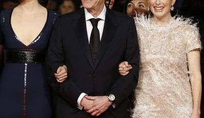 From left, actress Mia Wasikowska, director David Cronenberg, and actress Julianne Moore arrive for the screening of Maps to the Stars at the 67th international film festival, Cannes, southern France, Monday, May 19, 2014. (AP Photo/Alastair Grant)