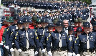 Thousands of police from around the country march to a memorial service for Brentwood, N.H., police Officer Stephen Arkell Wednesday May 21m 2014 in Exeter, N.H. Arkell was shot and killed last week when he responded to a domestic dispute call.(AP Photo/Jim Cole)