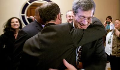 Minneapolis bid committee member Steve Gordon, right, celebrates with colleagues after Minneapolis was selected as the host for the 2018 Super Bowl at the NFL's spring meeting, Tuesday, May 20, 2014, in Atlanta. Minneapolis will host the 2018 Super Bowl after a vote by owners on Tuesday rewarded the city for getting a new stadium deal. The owners chose Minneapolis and the new $1 billion stadium planned for the site of the old Metrodome to host the championship over New Orleans and Indianapolis. (AP Photo/David Goldman)