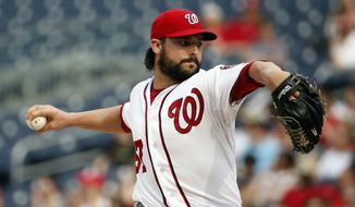 Washington Nationals starting pitcher Tanner Roark throws during the third inning of a baseball game against the Cincinnati Reds at Nationals Park Wednesday, May 21, 2014, in Washington. (AP Photo/Alex Brandon)