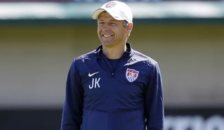 United States head coach Jurgen Klinsmann smiles as his team trains in preparation for the World Cup soccer tournament on Wednesday, May 21, 2014, in Stanford , Calif. (AP Photo/Marcio Jose Sanchez)