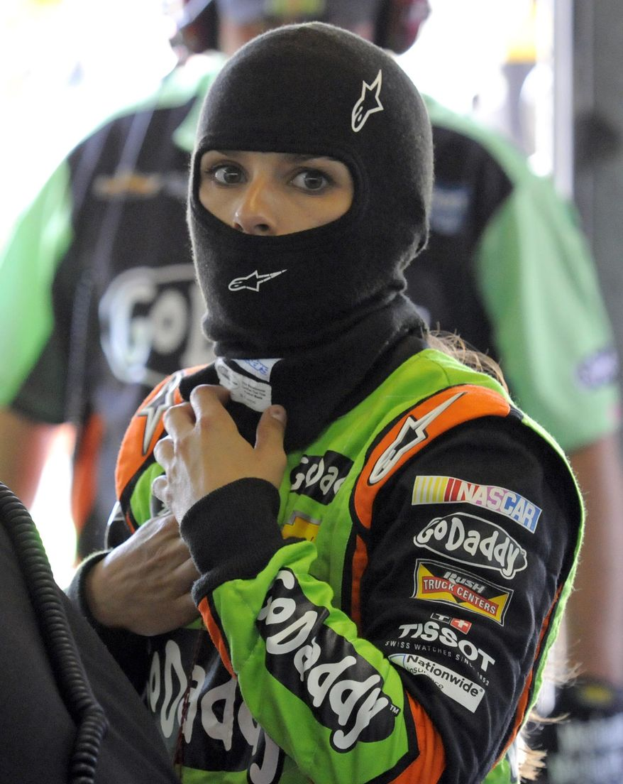 Danica Patrick prepares before practice for Sunday's NASCAR Sprint Cup series auto race at Charlotte Motor Speedway in Concord, N.C., Thursday, May 22, 2014. (AP Photo/Mike McCarn)