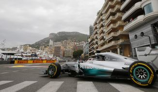 Mercedes driver Lewis Hamilton of Britain steers his car during the first free practice at the Monaco racetrack, in Monaco, Thursday, May 22, 2013. The  Monaco Formula One Grand Prix will be held on Sunday. (AP Photo/Luca Bruno)