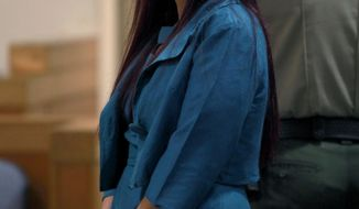 Delia Garcia-Bratcher appears during a hearing at the Sonoma County Superior Court in Santa Rosa, Calif. on Thursday, May 22, 2014.  Garcia-Bratcher, was arrested Saturday on suspicion of inflicting injury on a child after sheriff's deputies say she came to Olivet Elementary Charter School in Santa Rosa on Friday and grabbed the boy by the throat. She asked her son, who also attends the school, to point out who was bullying her daughter, the sheriff's office said. (AP Photo/The Press Democrat, Beth Schlanker)