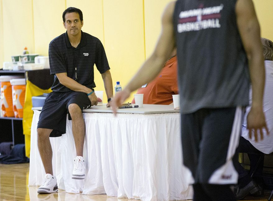 Miami Heat coach Erik Spoelstra watches his team during a practice session in Miami, Thursday, May 22, 2014, as they prepare for  game three in their playoff series against the Indiana Pacers. (AP Photo/J Pat Carter)