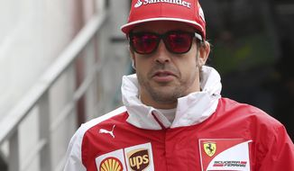 Ferrari driver Fernando Alonso, of Spain, arrives at pits prior to the start of the first free practice session at the Monaco racetrack, in Monaco, Thursday, May 22, 2014. The Monaco Formula One Grand Prix will be held on Sunday. (AP Photo/Antonio Calanni)