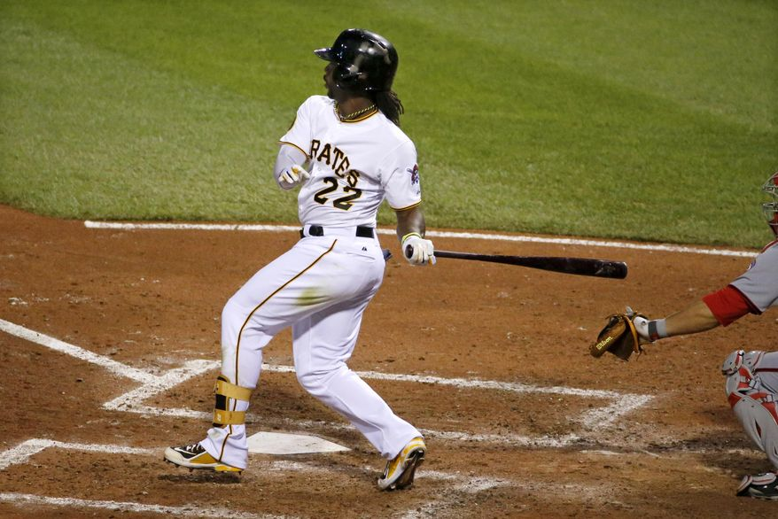 Pittsburgh Pirates' Andrew McCutchen drives in a run with a single off Washington Nationals starting pitcher Blake Treinen  during the fifth inning of a baseball game in Pittsburgh Thursday, May 22, 2014. (AP Photo/Gene J. Puskar)