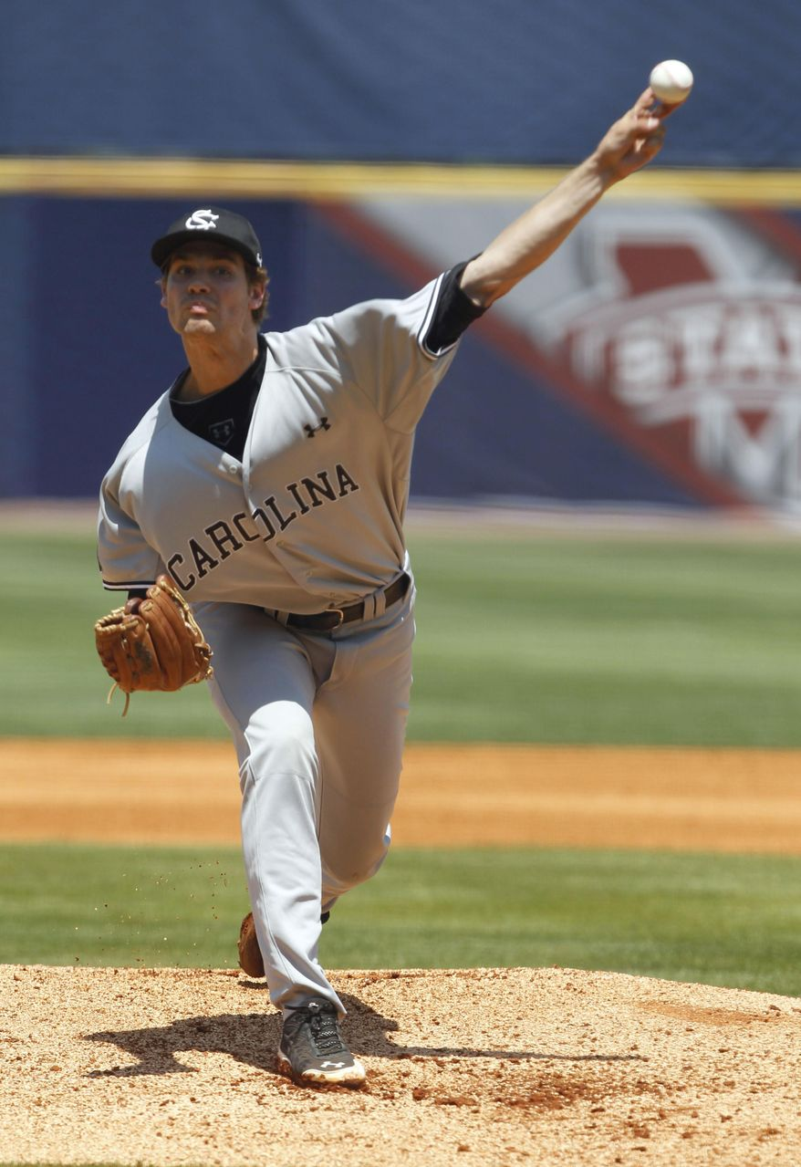 South Carolina's Jack Wynkoop pitches against Florida during the first inning at the Southeastern Conference NCAA college baseball tournament on Thursday, May 22, 2014, in Hoover, Ala. (AP Photo/Butch Dill)