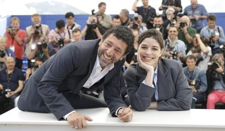 Actor Kamel Abdelli, left, and actress Heloise Godet pose for photographers during a photo call for Goodbye to Language (Adieu au language) at the 67th international film festival, Cannes, southern France, Wednesday, May 21, 2014. (AP Photo/Thibault Camus)