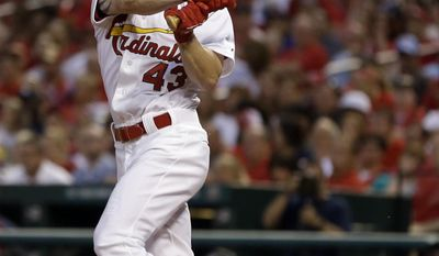 St. Louis Cardinals' Shane Robinson watches his two-run double during the sixth inning of a baseball game against the Arizona Diamondbacks on Thursday, May 22, 2014, in St. Louis. (AP Photo/Jeff Roberson)