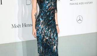 Singer Conchita Wurst arrives at the amfAR Cinema Against AIDS benefit at the Hotel du Cap-Eden-Roc, during the 67th international film festival, in Cap d'Antibes, southern France, Thursday, May 22, 2014. (Photo by Joel Ryan/Invision/AP)