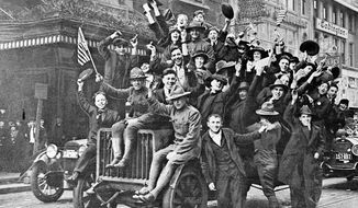 Celebrants cheer near New York City's Times Square as news of the Armistice spreads on Nov. 11, 1918. (associated press)