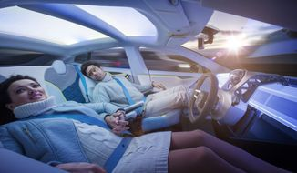 """Down the road: Rinspeed presents a vision of road travel it says is just """"a few short years from now."""" The Swiss car company touted its creation at the Geneva Motor Show as an office and living room on wheels. (Rex Features via Associated Press)"""